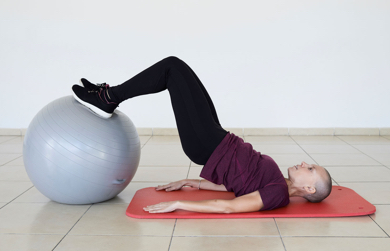 Woman using exercise ball - Strength After Breast Cancer